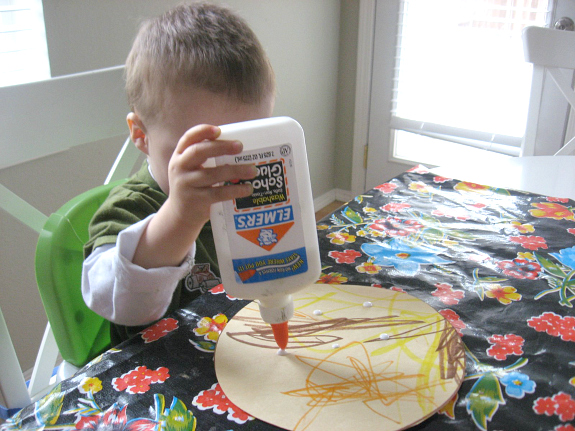 gluing shapes on the pizza craft