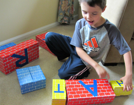 spelling with letter blocks