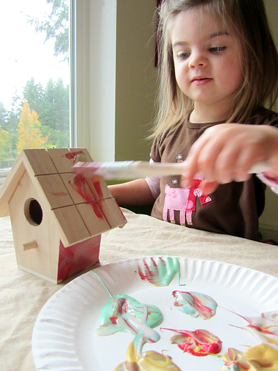 painting elf houses for Christmas