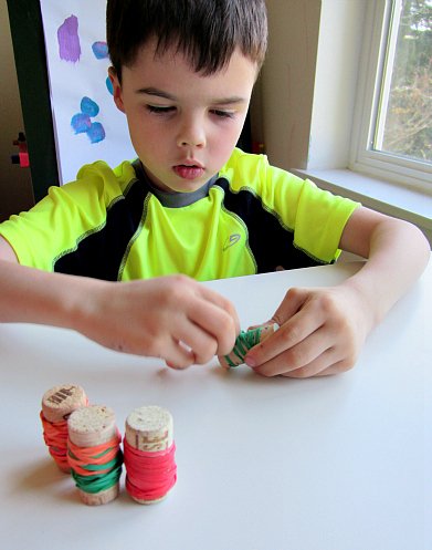 fine motor cork and rubber bands