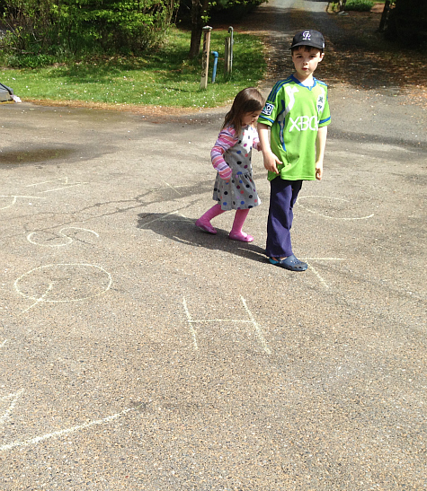 letter activities and spelling with sidewalk chalk