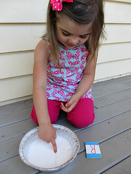dollar store learning letters with a salt tray