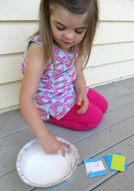 learning to form letters with a salt tray