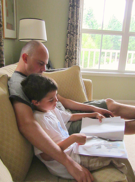 kid made action figure book reading with daddy