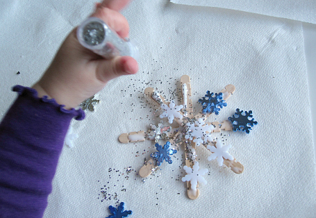 glitter and confetti popscicle stick snowflake christmas ornaments