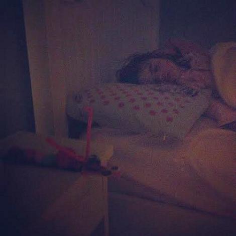 sleeping with her caterpillar craft