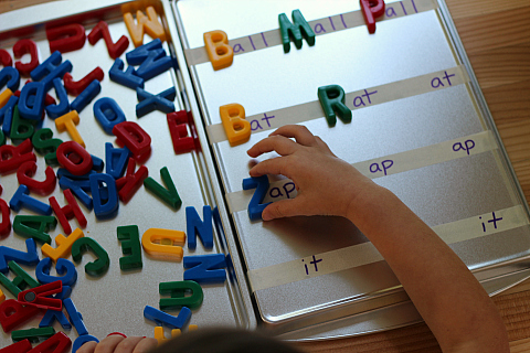 building words with letter magnets word family game