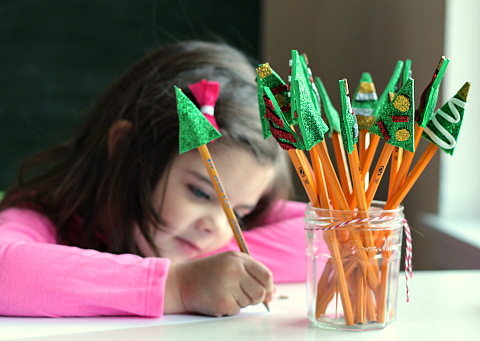 Christmas tree pencil toppers encourage writing
