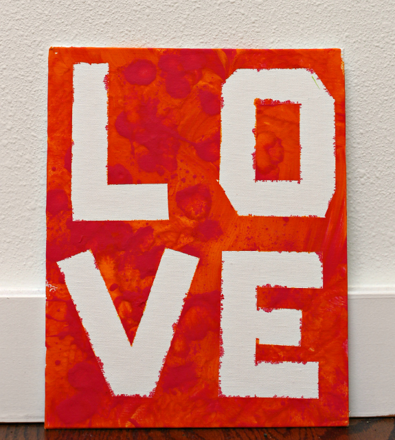 love sign close up squeeze painting