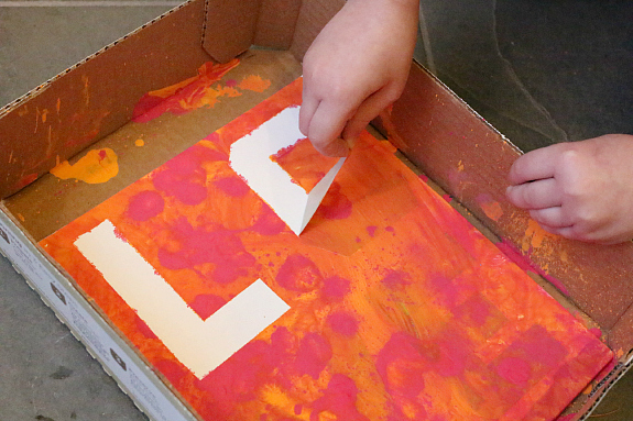 love sign tape resist squeeze paint