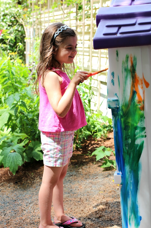 painting the play house art outside for kids