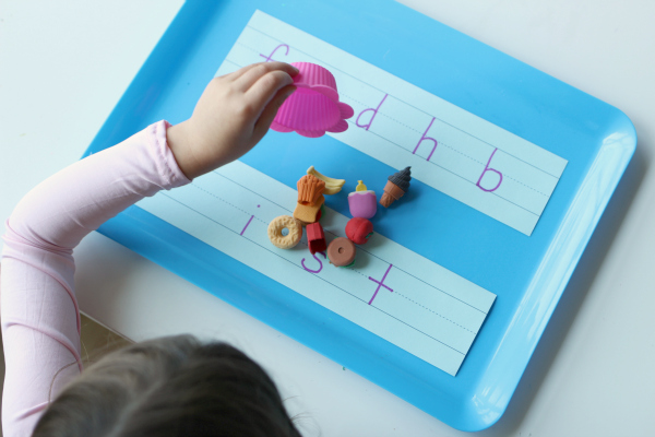 Letter sounds matching with mini erasers for kindergarten
