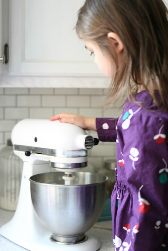 mixing the cookies canister