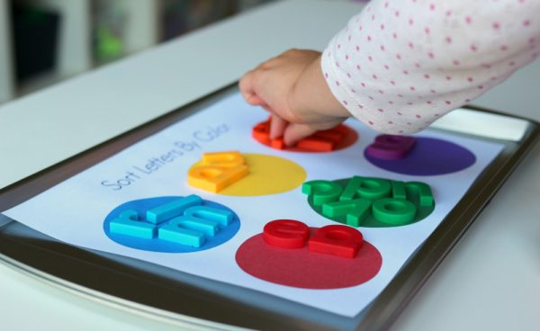 color sorting with lowercase letter magnets in preschool