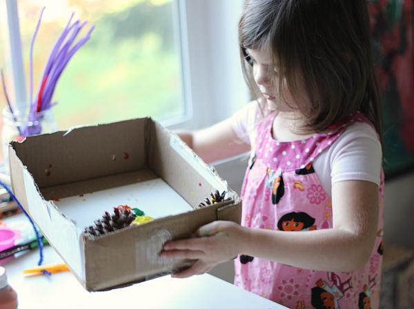 pinecone-painting-in-preschool-process-art