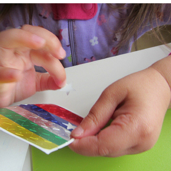 Peeling stickers and developing fine motor skills