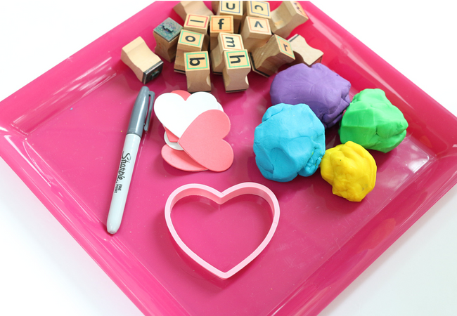 valentine's day literacy activity stamping hearts