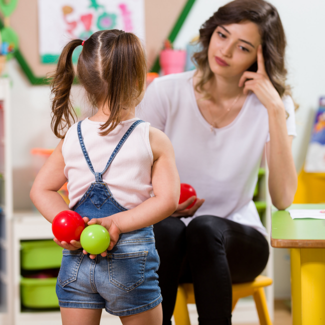 preschool teacher using good tools for behavior management